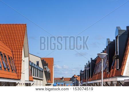 Street of red tiled roofs with skylights in the Netherlands