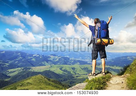 Tourist on high mountain peak. Sport and active life concept