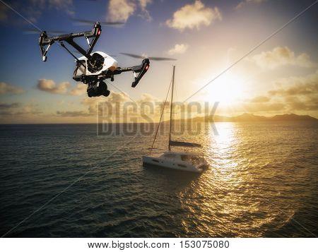 Drone flying above catamaran yacht on open ocean in beautiful sunset light