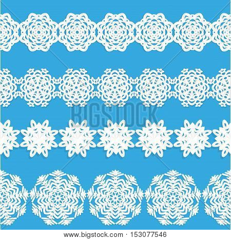 Set of seamless smooth garlands of white paper snowflakes on a blue background. Four species