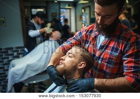 Working hairdresser in a barber shop
