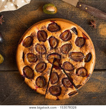 Plum cake on wooden rustic background. Close up