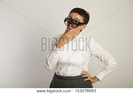 Teacher In White Blouse With 3 Pairs Of Glasses