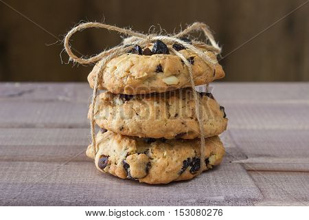 Closeup of pile made from homemade moms chocolate cookies on wooden background