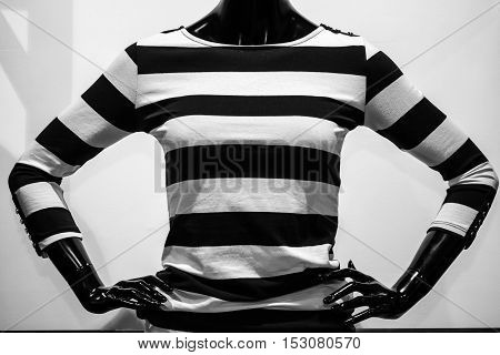 Striped fashion blouse in black and white. Lifestyle.