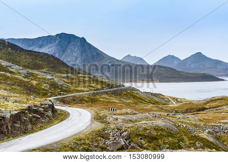 Turning mountain asphalt road with sky and sea