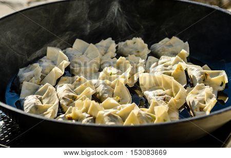 Making Homemade Gyoza - Japanese Dumplings In Frying Pan.