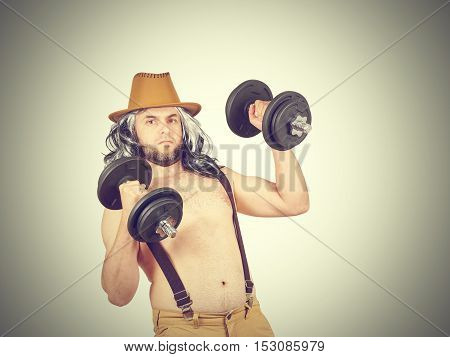 Man In Hat With Dumbbells
