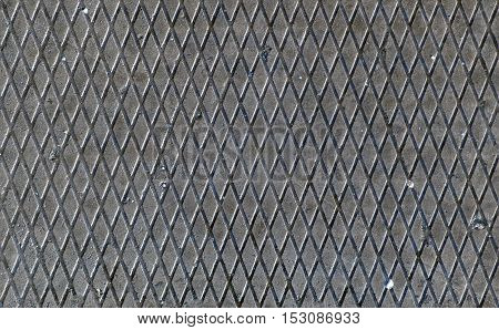 Industrial background. Texture of metal rusty surface of rhombuses.
