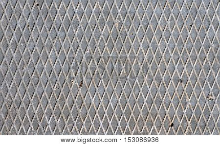 Industrial background. Texture of gray concrete surface of rhombuses.