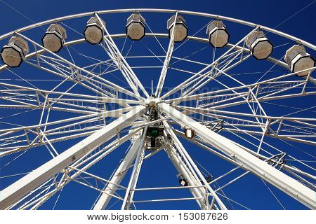 Cardiff, UK, September 14, 2016: The Cardiff Eye giant Ferris wheel, which is a popular tourist attraction operating in Cardiff Bay