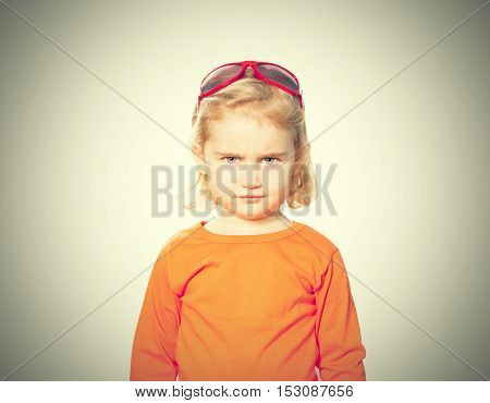 Little Girl In Red Sunglasses On Head .