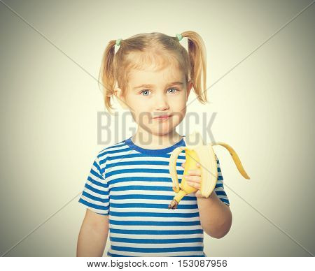 Little Funny Girl Eats Banana.