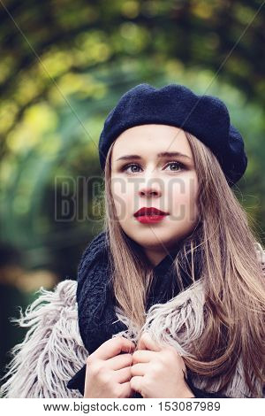 Beautiful young woman in a beret in the French style