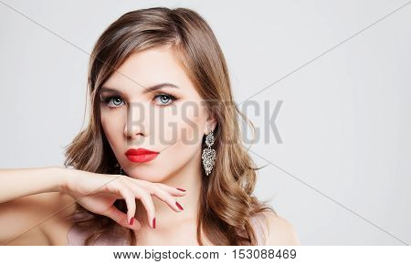 Glamorous Girl Fashion Model with Red Lips and Red Nails