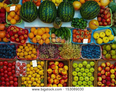 A wide range of fruits and vegetables on the market. View from the top of the counter