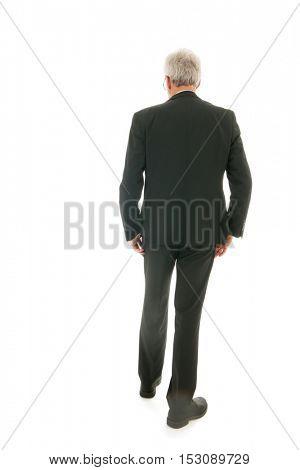 Senior business man walking away