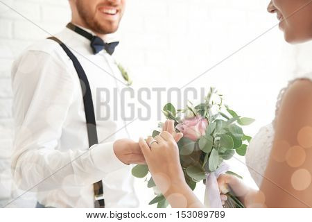 Groom and bride holding hands together