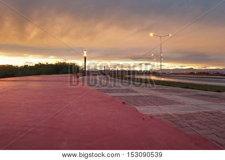 Quite boulevard with amazing colorful patagonian sunset