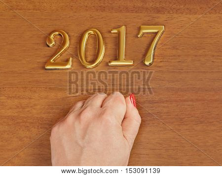 Hand and numbers 2017 on door - new year concept background