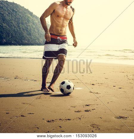 Man Beach Summer Holiday Vacation Football Concept