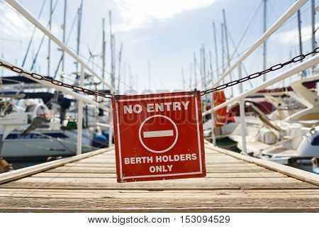 Warning sign at the entrance to the yacht pier Agios Nikolaos Greece