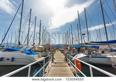 Agios Nikolaos Greece - October 10 2016: The pier with yachts parked in a bay autumn time