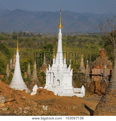 Shwe Inn Thein Paya Indein (Nyaungshwe) Inle LakeShan state myanmar (Burma). Weather-beaten buddhistic zedi constructed in 17th and 18th century damaged by earthquake in 1975 partitialy back reconstructed.