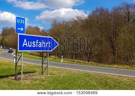 a german road sign: signpost at junction translation: exit