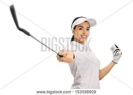 Female golfer pointing a golf club at the camera and holding a golf ball isolated on white background