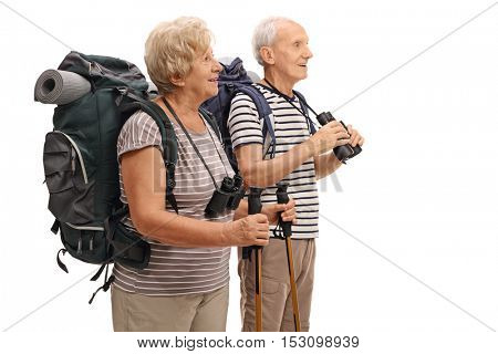 Mature hikers looking in the distance isolated on white background