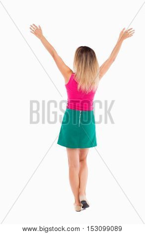 Back view business woman. Raised his fist up in victory sign. Raised his fist up in victory sign.  Rear view people collection. Isolated over white background. Girl in a green skirt lifted her arms up