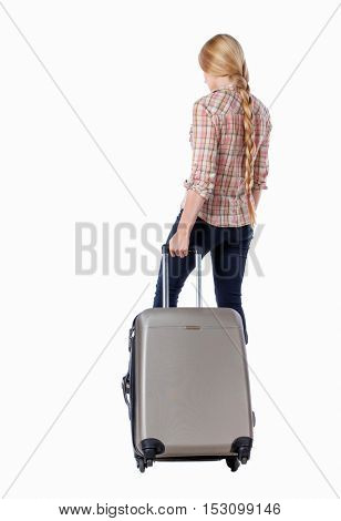 Back view woman with suitcase looking up. Standing young girl. Rear view people collection.  backside view person. Isolated over white background. Girl with very long hair pulling a suitcase on wheels