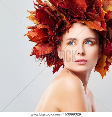 Autumn Beauty. Beautiful Woman in Wreath of Fall Leaves