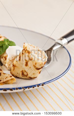 Thin Crepes Rolled Pancakes With Sour Cream Mint On A Plate
