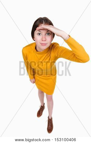 Funny portrait of a woman gazing into the frame. Wide-angle. Isolated over white background. A girl in a short orange dress looks in the frame.