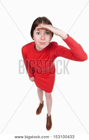 Funny portrait of a woman gazing into the frame. Wide-angle. Isolated over white background. A girl in a short red dress looks in the frame.