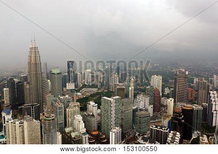 Kuala Lumpur Malaysia - Janauary 17. 2016: Dramatic scenery of the KualaLumpur city at sunset from the KL-Tower Menara KL .