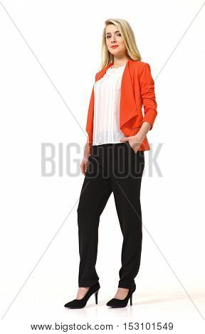 woman with straight hair style in orange casual jacket and black trousers high heels shoes full length body portrait standing isolated on white