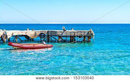rubber boat near the pier in the sea.