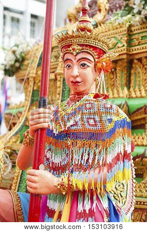Suratthani, Thailand - October 20, 2016: Ornamented carriers of Buddha images depicting Manohra dancer to be pulled across the city during the famous Chak Phra Festival, an annual Buddhist festival to celebrate the return of Buddha from heaven to earth af