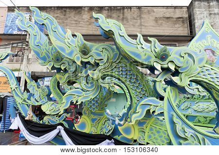 Suratthani, Thailand - October 20, 2016: Details on ornamented carriers of Buddha images to be pulled across the city during the famous Chak Phra Festival, an annual Buddhist festival to celebrate the return of Buddha from heaven to earth after the end of