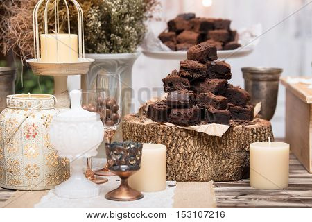 Chocolate Brownies In Stacked On Wooden Table