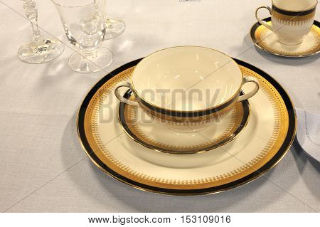 Elegant Dish With Cup Of Fine Ceramics On The Table