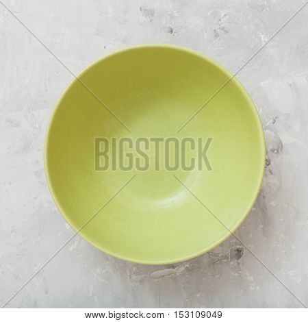 Above View Of Green Bowl On Concrete Plate