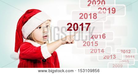 New Year Child in Santa Hat. Christmas and New Year's Eve Concept