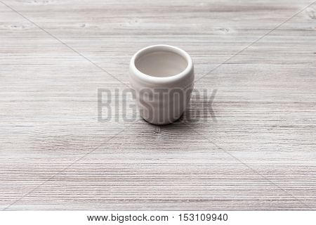 White Cup For Sake On Gray Brown Wooden Table