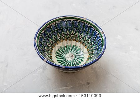 One Central Asian Bowl On Gray Concrete Plate