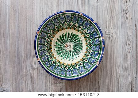 Top View Of Central Asian Bowl On Gray Brown Table