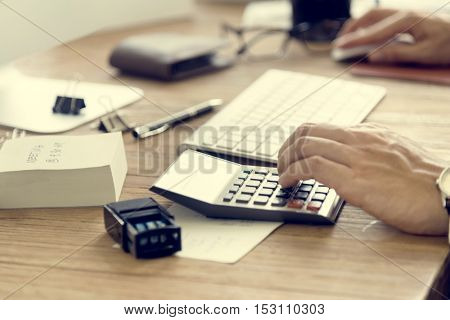 Man Hands Using Calculator Concept